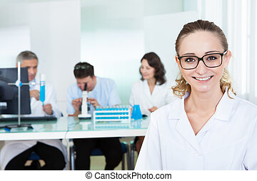 Attractive female lab technician - Attractive smiling female...