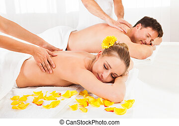 Attractive couple having a massage - Attractive couple lying...