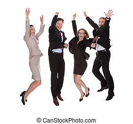 Four business partners jumping for joy - Four diverse...