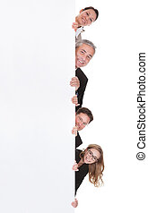 Businesspeople peering around a blank banner