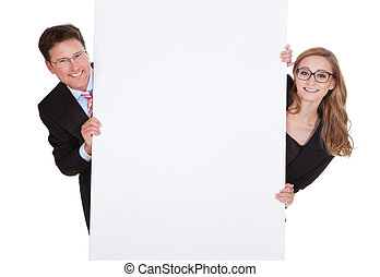 Professional man and woman with a blank sign - Smiling...