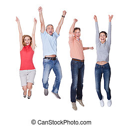 Happy couples jumping in the air rejoicing - Two happy...