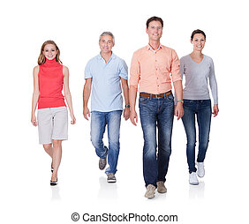 People walking towards the camera - Group of four people...