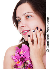 Woman with beautiful nails holding orchids