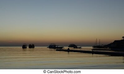 Timelaps of sunrise at Naama Bay, Red Sea and motor yachts,...