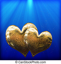 Two golden hearts as a symbol of love - two golden hearts in...
