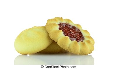 Strawberry biscuit on  white reflective background.