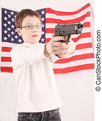 gun - A child holds a pistol