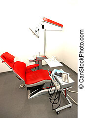 Dentist chair - Dentist`s workplace with red chair and tools