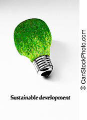 grass inside light bulb on white, sustainale development