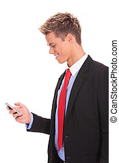 business man texting on smartphone