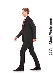 young business man walking forward - picture of a young...