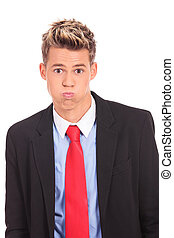 Crazy business man making funny faces on white background