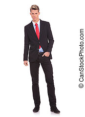 man standing with hand in pocket - View of business man...