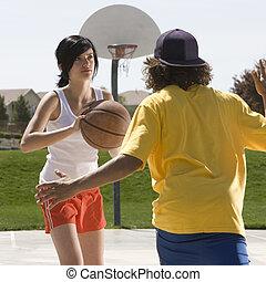 Teens play basketball
