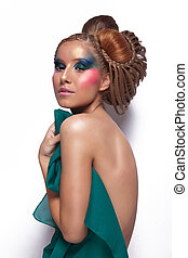 naked woman with great hair and makeup covering herself