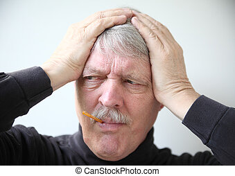 senior man with flu symptoms