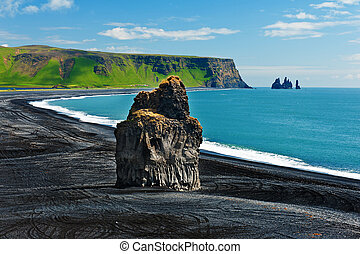 Cape Dyrholaey - Beautiful rock formation on a black...