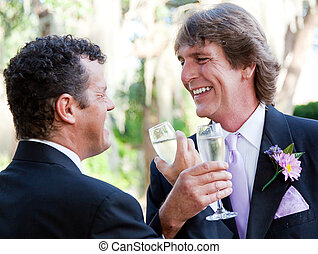 Gay Couple Toast Their Marriage - Handsome gay couple at...