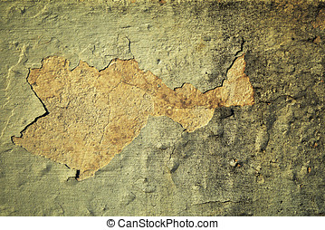 Grunge wall with flaking plaster