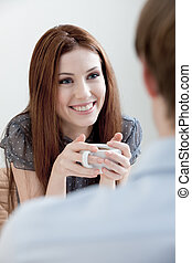 Woman with man at the cafe - Woman and man are sitting at...