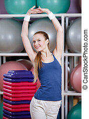 Athletic woman stretching herself - Athletic woman in...
