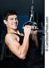 Athletic man works out on fitness gym training - Athletic...
