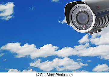 Security camera on the blue sky background
