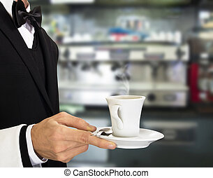 young waiter in work uniformon with coffee