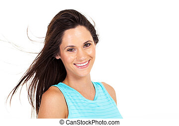 beautiful young woman smiling over white background