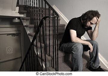 Overwhelming Depression - A male adult with overwhelming...