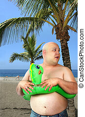 Inflatable fun - A large man with inflatable toy gets ready...