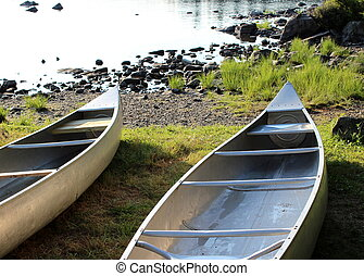 Sunshine on two resting canoes