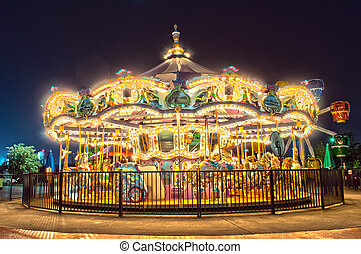 carousel at night - View of a carousel at night,
