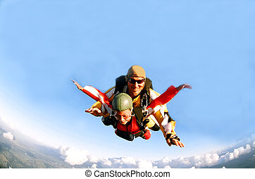 Portrait of two skydivers in action - Portrait of two tandem...