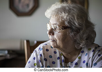 Elderly woman looking to the side - elderly woman in natural...