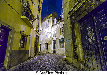 Lisbon at night, streets and old houses of the historic...
