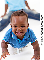 cute african baby boy crawling on floor - cute african...