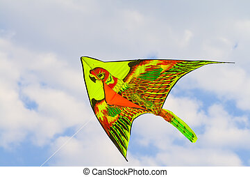 Kite - A kite flying against a blue sky in sunlight, bright...