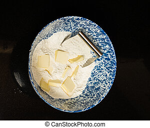 Bowl of flour and butter to make dough