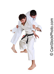Karate. Men in a kimono with a white background.