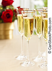Wedding reception setting with champagne and flowers