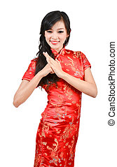 pretty girl with cheongsam wishing you a happy Chinese new...