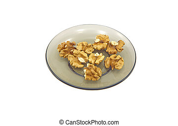 Walnuts - Some walnuts on a glass plate isolated on a white...