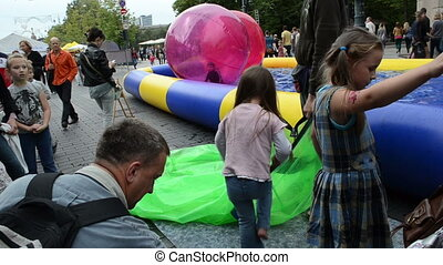 girl zorb ball pool - VILNIUS, LITHUANIA - SEPTEMBER 1: Girl...