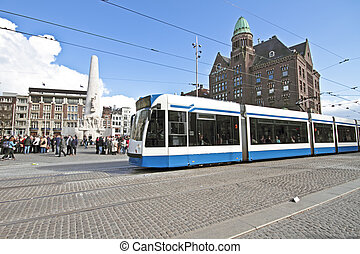 Tram driving at Dam square in Amsterdam the Netherlands