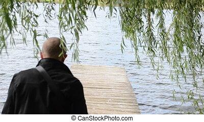 man swan bird bridge pier