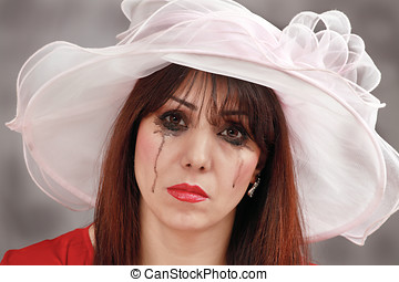 Widow - Tearful widow in formal hat with mascara smudging...