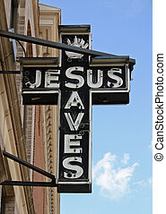 Jesus Sign - An unlit neon sign reading Jesus Saves