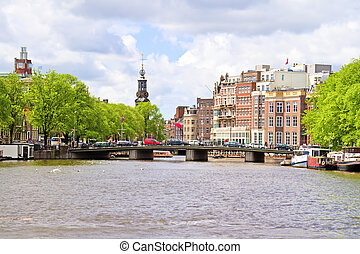 City scenic from Amsterdam with the Munt tower in the...